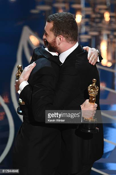 Songwriter Jimmy Napes and singersongwriter Sam Smith accept the Best Original Song award for 'Writing's on the Wall' from 'Spectre' onstage during...