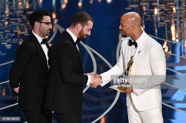 Songwriter Jimmy Napes and singersongwriter Sam Smith accept the Best Original Song award for 'Writing's on the Wall' from 'Spectre' onstage...