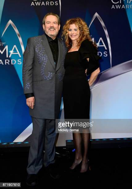 Songwriter Jimmy Webb and Laura Savini pose in the press room during the 51st annual CMA Awards at the Bridgestone Arena on November 8 2017 in...