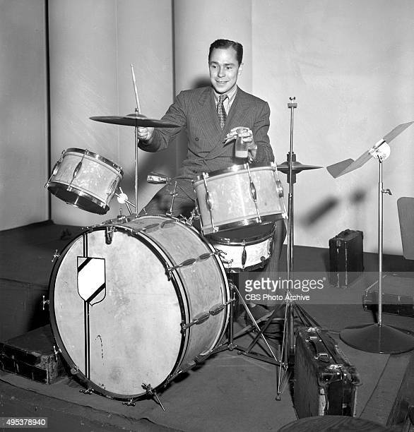 Songwriter Johnny Mercer playing drums He performs regularly on The Camel Caravan radio program January 17 1939 New York NY