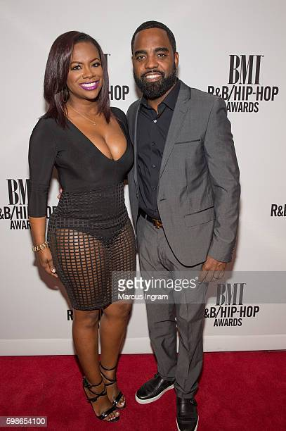 Songwriter Kandi Burruss Tucker and Todd Tucker attend the 2016 BMI RB/HipHop Awards at Woodruff Arts Center on September 1 2016 in Atlanta Georgia