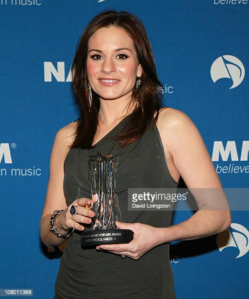 Songwriter Kara DioGuardi poses with her NAMM's 2011 Music for Life Award at the 2011 NAMM Show - Day 1 at the Anaheim Convention Center on January...