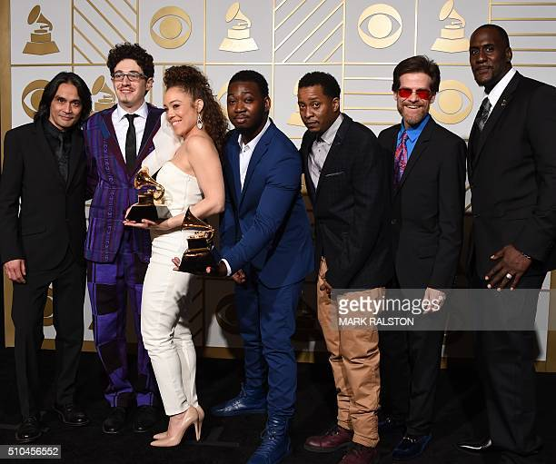 Songwriter Kendra Foster and The Vanguard celebrate her Best RB Song trophy for 'Really Love' in the press room during the 58th Annual Grammy Music...