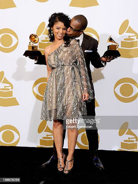 Songwriter Kirk Franklin winner of the GRAMMYs for Best Gospel Album and Best Gospel Song poses with his wife Tammy Franklin in the press room at the...