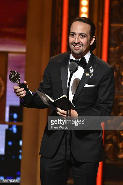 "Songwriter Lin-Manuel Miranda accepts the award for Best Book of A Musical for ""Hamilton"" onstage during the 70th Annual Tony Awards at The Beacon..."