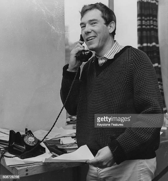 Songwriter Mike Pratt, composer of the new musical 'The Big Client' at the Bristol Old Vic, pictured making a phone call, circa 1961.