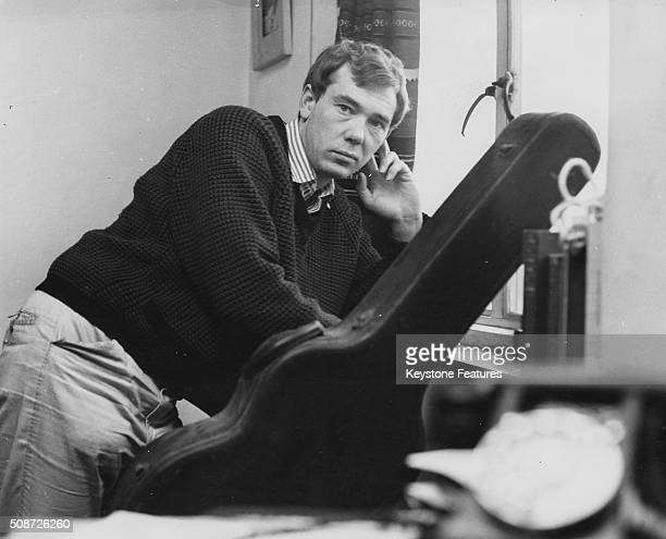 Songwriter Mike Pratt composer of the new musical 'The Big Client' at the Bristol Old Vic pictured with his guitar circa 1961