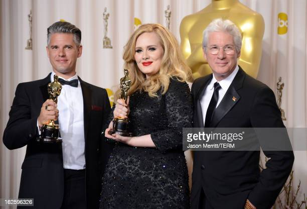 Songwriter Paul Epworth and singer Adele winners of the Best Original Song award for Skyfall with presenter Richard Gere pose in the press room...
