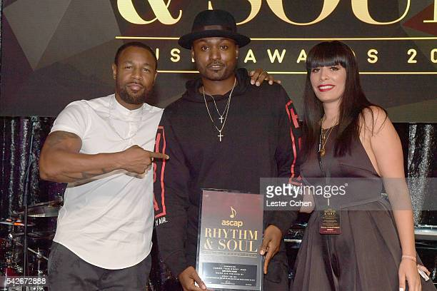 Songwriter Sam Hook accepts the award for Winning RB/Hip Hop Song for 'Post to Be' with singer Tank and ASCAP Rhythm Soul Director Jennifer...