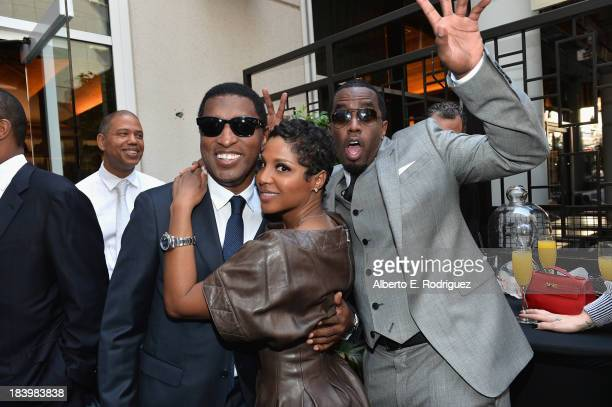 Songwriter/record producer Kenny Babyface Edmonds singer Toni Braxton and businessman/singer Sean Combs attend a ceremony honoring Kenny Babyface...