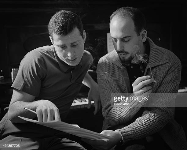 Songwriters and producers Jerry Leiber and Mike Stoller pose for a portrait in Stoller's apartment in 1959 in New York City New York