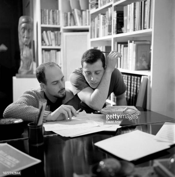 Songwriters and producers Jerry Leiber and Mike Stoller work on a song in Leiber's apartment in 1959 in New York City New York