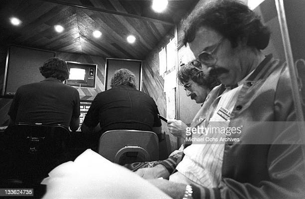 Songwriters and producers LR Pete bellotte and Giorgio Moroder backstage at the taping of a Donna Summer concert circa 1977 in Los Angeles California