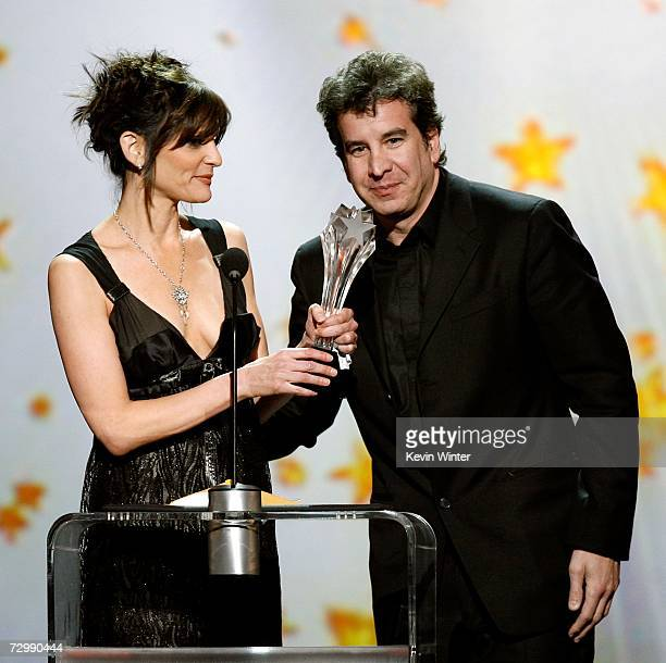 Songwriters Anne Preven and Scott Cutler accept the 'Best Song' award for 'Listen' onstage during the 12th Annual Critics' Choice Awards held at the...