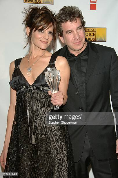 Songwriters Anne Preven and Scott Cutler pose in the press room with their award for Best Song at the 12th Annual Critics' Choice Awards held at the...