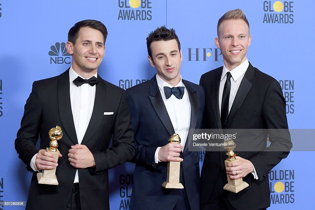 Songwriters Benj Pasek, Justin Hurwitz and Justin Paul, winners of Best Original Song for 'City of Stars' from 'La La Land,' poses in the press room during the 74th Annual Golden Globe Awards at The Beverly Hilton Hotel on January 8, 2017 in Beverly Hills, California.