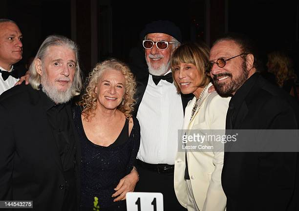 Songwriters Gerry Goffin Carole King Lou Adler Cynthia Weil and Barry Mann pose during the 60th annual BMI Pop Awards at the Beverly Wilshire Four...