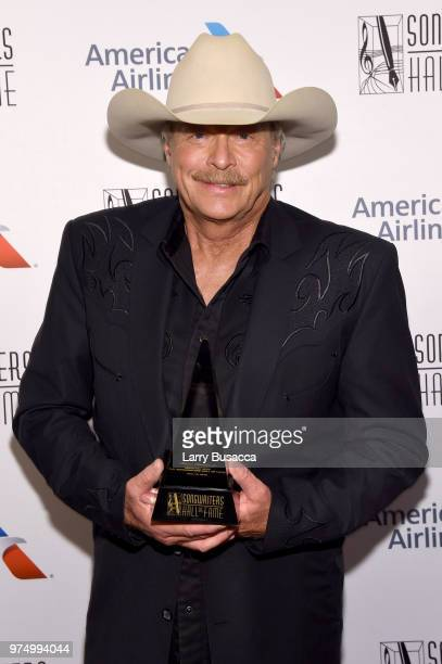 Songwriters Hall of Fame Inductee Alan Jackson poses with an award backstage during the Songwriters Hall of Fame 49th Annual Induction and Awards...