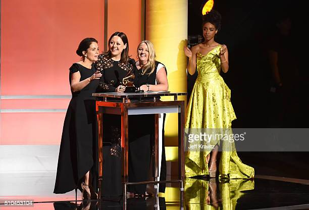 Songwriters Hillary Lindsey Lori McKenna and Liz Rose alongside singer Lianne La Havas accept the award for Best Country Song for 'Girl Crush'...