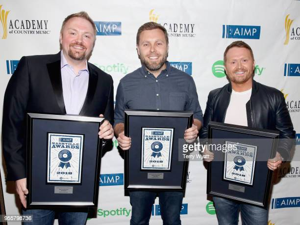 Songwriters Josh Osborne Zach Crowell and Shane McAnally hold their awards for Spotify Country Top Spot at the 3rd Annual AIMP Awards at Ryman...