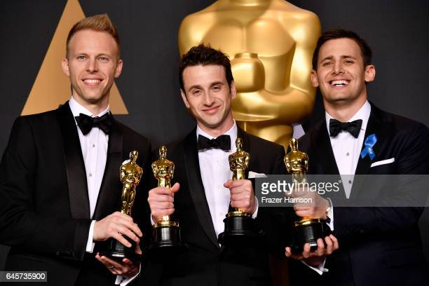 Songwriters Justin Paul Justin Hurwitz and Benj Pasek winners of the Best Original Song award for 'City of Stars' pose in the press room during the...
