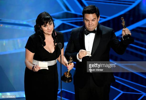 Songwriters Kristen AndersonLopez and Robert Lopez accept Best Original Song for 'Remember Me' from 'Coco' onstage during the 90th Annual Academy...