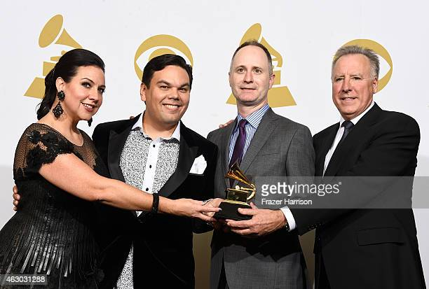 Songwriters Kristen AndersonLopez and Robert Lopez music supervisor Tom MacDougall and Walt Disney Music Company president Chris Montan winners of...
