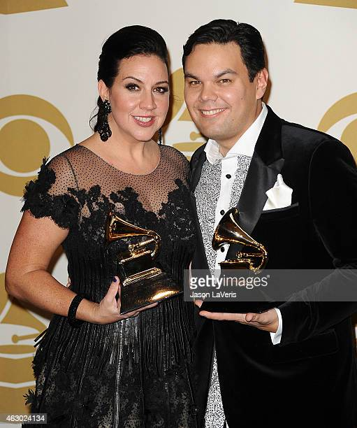 Songwriters Kristen AndersonLopez and Robert Lopez pose in the press room at the 57th GRAMMY Awards at Staples Center on February 8 2015 in Los...