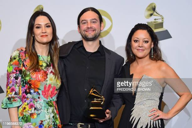 US songwriters Natalie Hemby Aaron Raitiere and Hillary Lindsey pose with the award for Best Song Written For Visual Media for I'll Never Love Again...