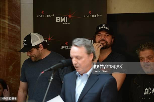 Songwriters Rhett Akins Dallas Davidson and Craig Wiseman watch as BMI's Jody Williams speaks during the Blake Shelton No 1 Party for Boys 'Round...