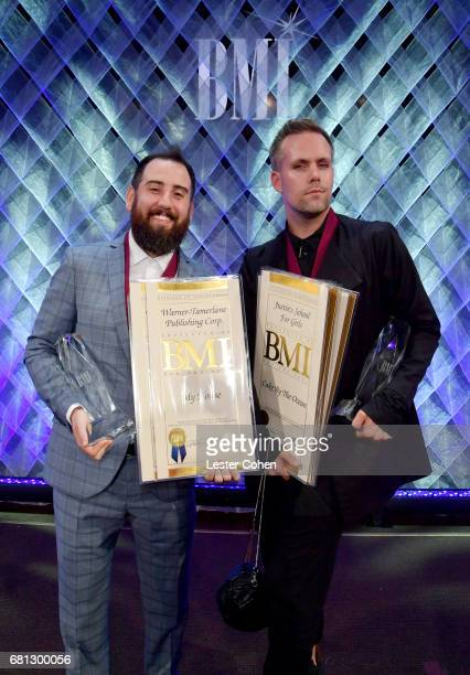 Songwriters Ross Golan and Justin Tranter winners of Songwriter of the Year pose onstage during the Broadcast Music Inc honors Barry Manilow at the...