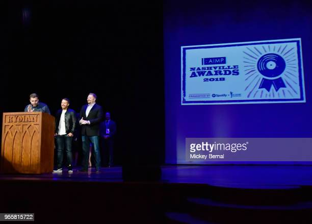 Songwriters Zach Crowell Shane McAnally and Josh Osborne accept an award onstage during the 3rd Annual AIMP Awards at Ryman Auditorium on May 7 2018...