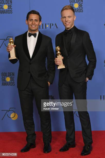 Songwriting duo Benj Pasek and Justin Paul pose with their award for Best Original Song in a Motion Picture for 'This Is Me' from 'The Greatest...