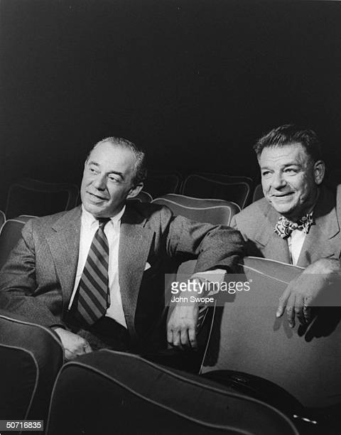 Songwriting team Richard Rodgers and Oscar Hammerstein sitting together in theater during time of South Pacific