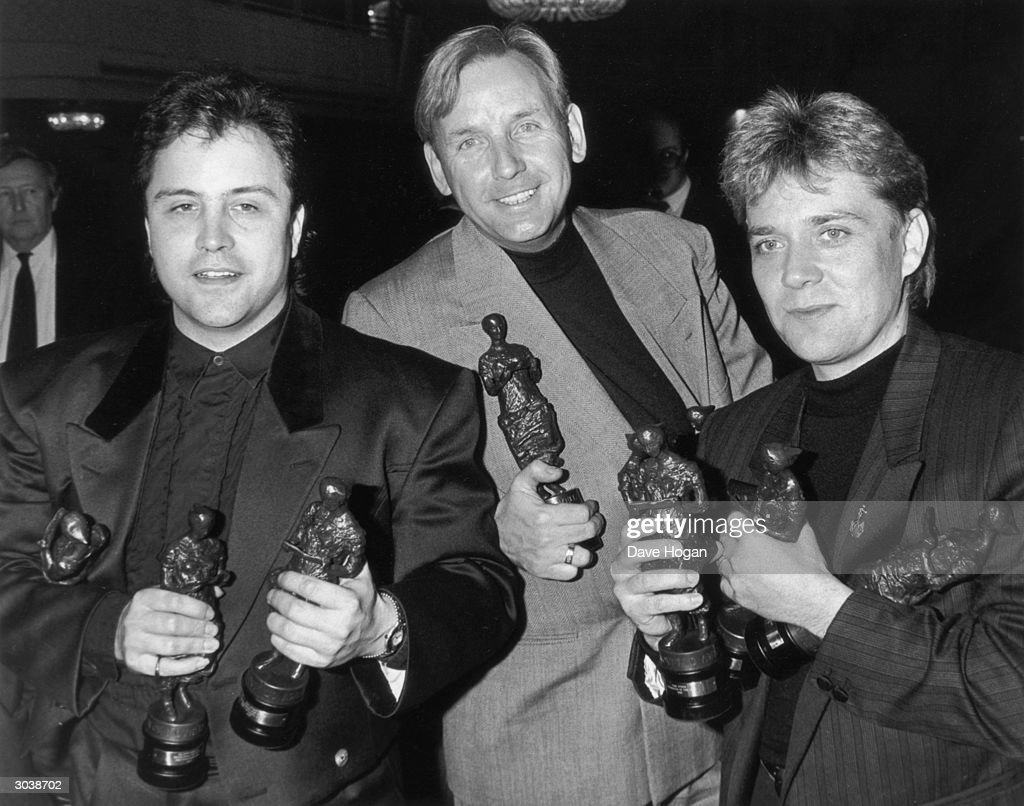 Songwriting trio Stock, Aitken and Waterman share their success at the Ivor Novello Awards, held at the Grosvenor House Hotel, 15th April 1988. They won awards for Songwriter of the Year, Most Performed Work and Best-Selling A-Side.