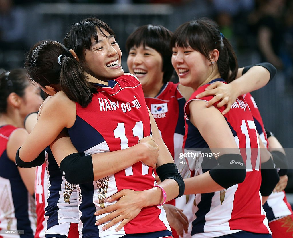 Song-Yi Han #12 and Yoo-Mi Han #11 of Korea celebrate the win over Italy during Women's Volleyball quarterfinals on Day 11 of the London 2012 Olympic Games at Earls Court on August 7, 2012 in London, England.