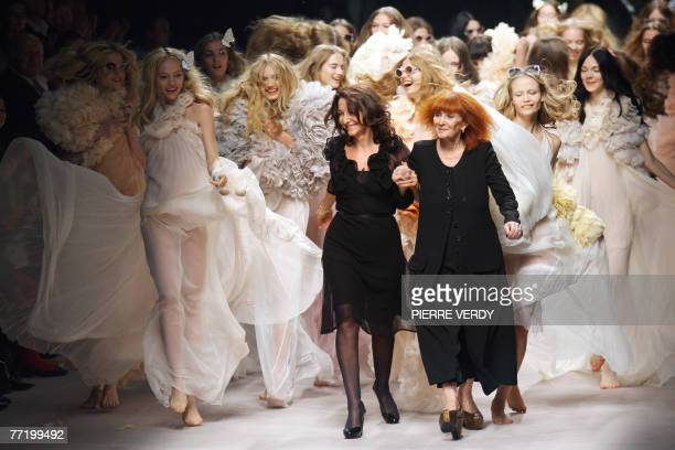 Sonia and Nathalie Rykiel acknowledge the public at the end of Spring/Summer 2008 ready-to-wear collection show in Paris, 05 October 2007. AFP PHOTO...
