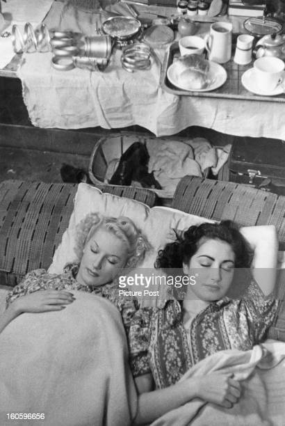 Sonia and Wenda, showgirls at the Windmill theatre, asleep in their dressing room under new rules for the dancers, lights out at 11. The girls dance...
