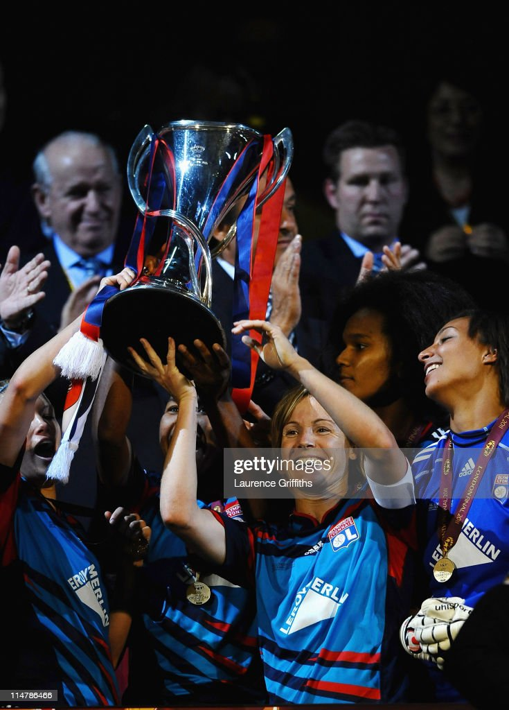 Sonia Bompastor of Lyon lifts the Trophy in celebration after victory in the UEFA Women's Champions League Final between Lyon and Turbine Potsdam at Craven Cottage on May 26, 2011 in London, England.