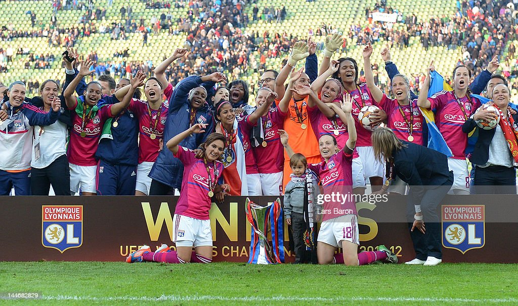Sonia Bompastor of Olympique Lyonnais (#18) celebrates with team mates after winning the UEFA Women's Champions League Final at Olympiastadion on May 17, 2012 in Munich, Germany.