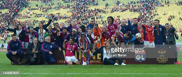 Sonia Bompastor of Olympique Lyonnais celebrates with team mates after winning the UEFA Women's Champions League Final at Olympiastadion on May 17...