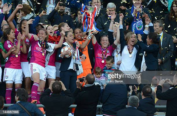 Sonia Bompastor of Olympique Lyonnais lifts the trophy and celebrates with team mates after winning the UEFA Women's Champions League Final at...