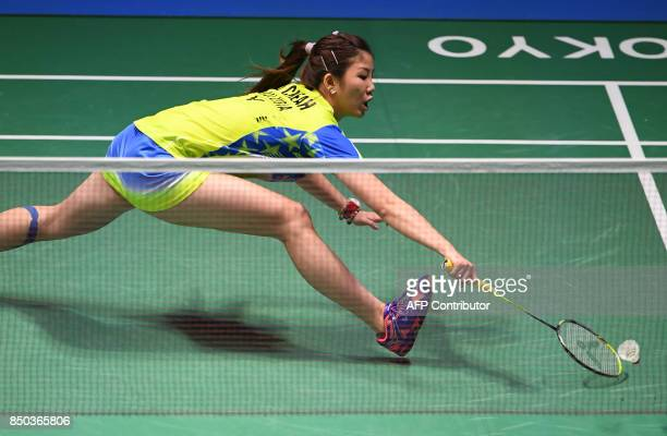 Sonia Cheah of Malaysia hits a return towards Zhang Beiwen of the US during their women's singles second round match at Japan Open Badminton...