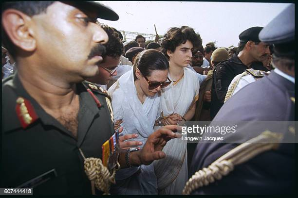 Sonia Gandhi and her daughter Priyanka walk among the crowd during the funeral procession of former Indian prime minister Rajiv Ghandi who was killed...