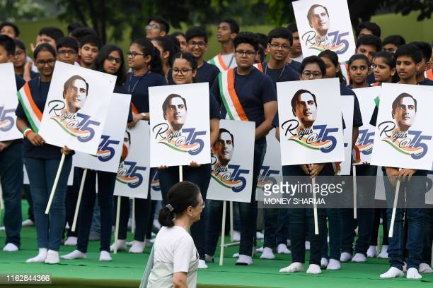 Sonia Gandhi , Congress Party interim president and wife of former Indian prime minister Rajiv Gandhi, greets children during a memorial ceremony to...