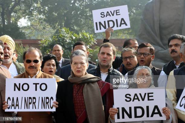 Sonia Gandhi, interim president of the Indian National Congress party, center left, and Rahul Gandi, former president of the INC party, center right,...