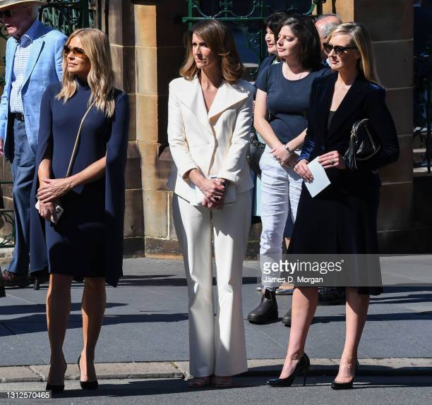 Sonia Kruger, Natalie Barr and Melissa Doyle watch as the hearse departs at the State Funeral for Carla Zampatti at St Mary's Cathedral on April 15,...