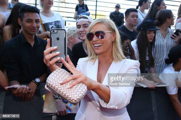 Sonia Kruger poses with fans on the red carpet ahead of the 31st Annual ARIA Awards 2017 at The Star on November 28 2017 in Sydney Australia