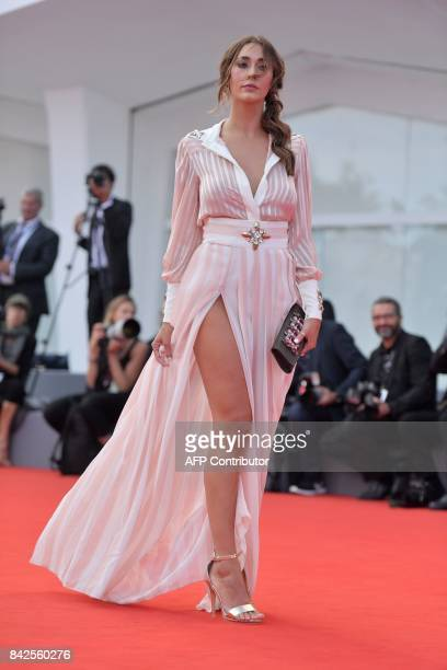 Sonia Lorenzini walks the red carpet before the premiere of the movie 'Una Famiglia' presented in competition at the 74th Venice Film Festival on...