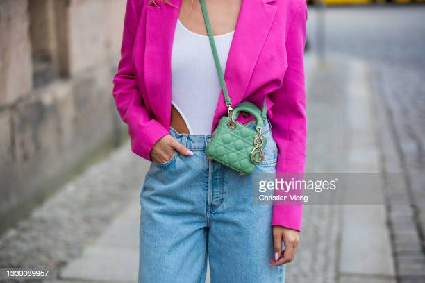 Sonia Lyson is seen wearing Adidas yeezy slippers, jeans &other stories, body in white Lumina, cropped pink blazer Zara, Dior micro lady dior bag,...